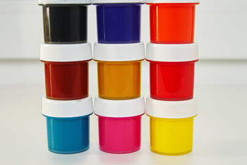 Jars with colorful paint