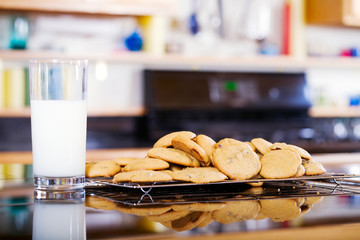 Snack of milk and cookies on kitchen counter