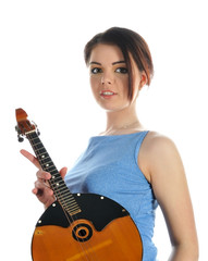 Young brunette girl holding a musical instrument.