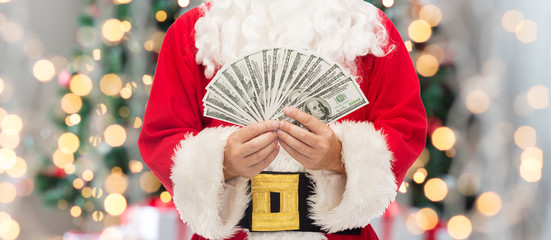 close up of santa claus with dollar money