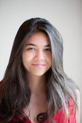 Beautiful biracial teen girl smiling at camera