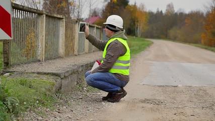 Engineer filmed with tablet PC old bridge