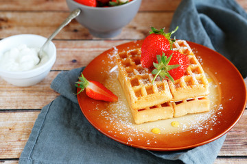 soft waffles with strawberries and cream