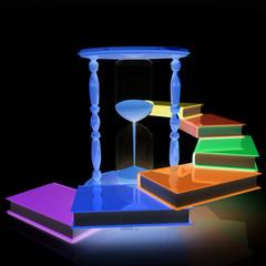 Hourglass and books