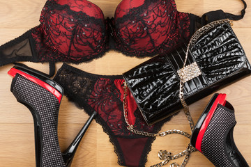 Lingerie, shoes and bag  lying on the laminate