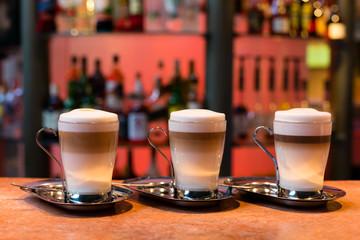 Three latte cups