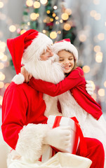 smiling little girl with santa claus