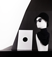 Mannequin wearing fashion sunglasses and hat