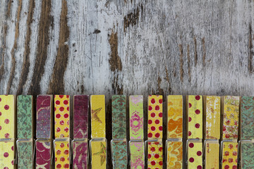 Handmade clothespins in a wood background