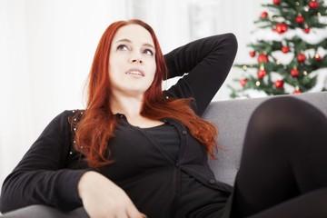 girl relax on sofa of christmas stress