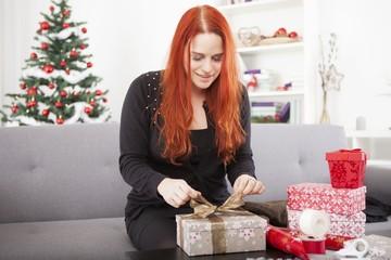 happy girl wrap christmas present boxes