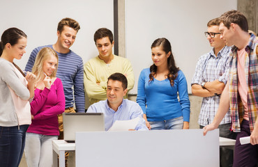 group of students and teacher with laptop