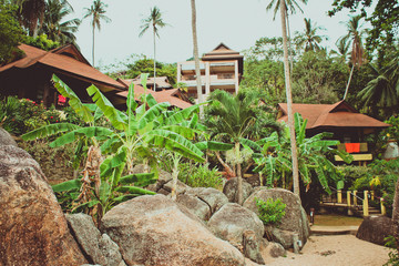 Hotel on tropical beach in retro colours, Koh Samui. Thailand