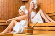 Two women in wellness spa enjoying sauna infusion