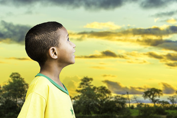 Brazilian little boy looks to the infinite