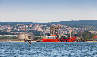 Tanker loading. Red cargo ship moored in Varna port, Bulgaria