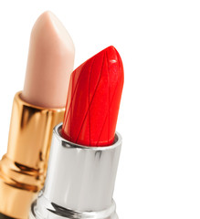 Red  and nude lipstickes  over white background