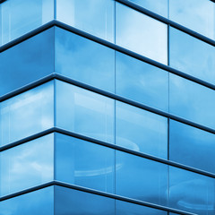 Modern office facade fragment, blue glass and steel frames