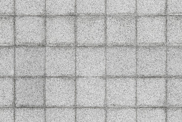Seamless background texture of gray stone tiling on the wall