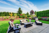Impressive backyard landscape design with patio area - 71710468