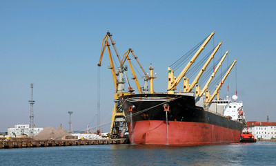 Loading with cranes of big industrial cargo ship in Burgas port