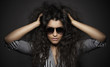 Portrait of beautiful woman with curly hairs and glasses