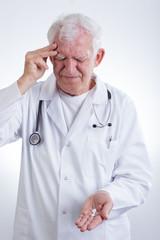 Experienced physician having headache