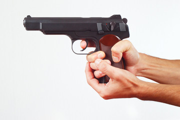 Hands with gun on a white background