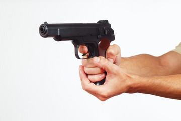 Hands with handgun on a white background