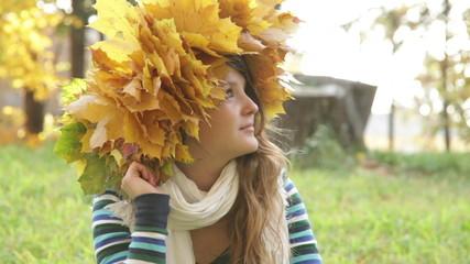 Cheerful woman relaxing in beautiful autumn day