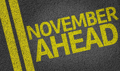 November Ahead written on the road