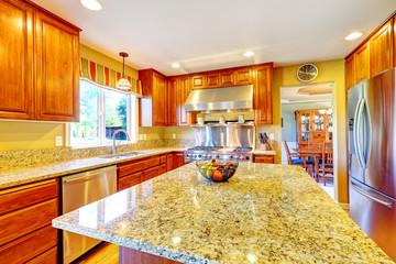 Shiny luxury kitchen room with island