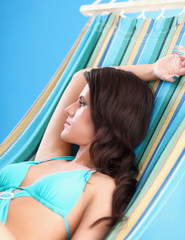 young woman relaxing in hammock