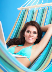 Portrait of young woman relaxing in hammock