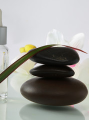Bottles of essential oil and set  stones