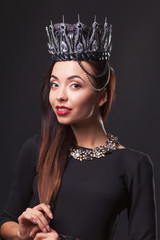 Beautiful woman with diamond crown and jewerly, isolated on