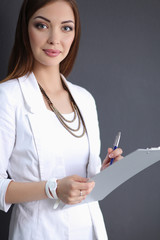 Portrait of a business woman holding  folder , Isolated on grey