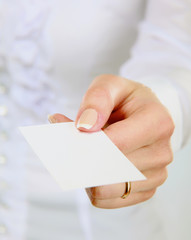 Businesswoman showing and handing a blank business card. Focus