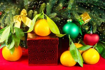 Mandarines next to Christmas tree