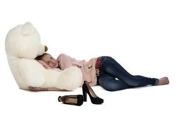 Portrait of teenage girl lying with teddy bear