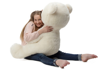 Portrait of girl hugging teddy bear
