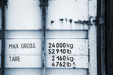Cargo container fragment with weight marks. Monochrome photo