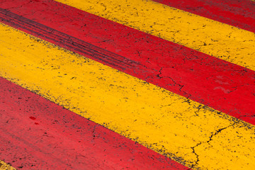 Pedestrian crossing road marking with yellow and red lines
