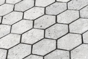 Background texture of gray honeycomb shaped cobblestone road