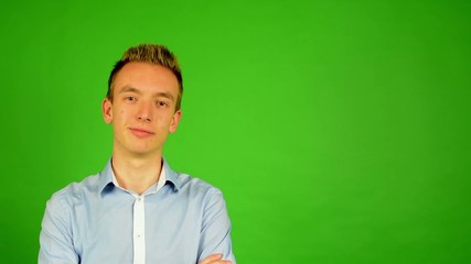 man - green screen - portrait - young man smiles (man is happy)