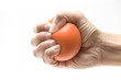 Hand squeezing a stress ball - 71718499
