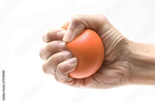 Leinwanddruck Bild Hand squeezing a stress ball