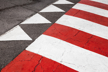 Pedestrian crossing road marking, red white lines and triangles