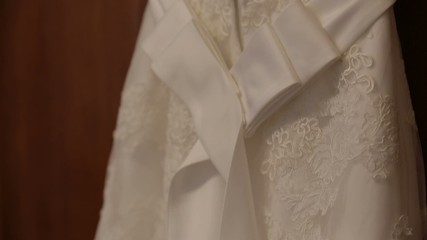 wedding dress hanging on a cupboard