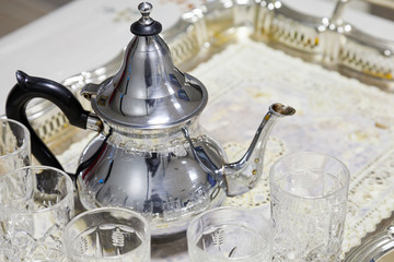 Arabic tea theme. Metal teapot with glasses
